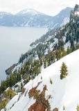 Forested cliffs. Surrounding Crater Lake Royalty Free Stock Image