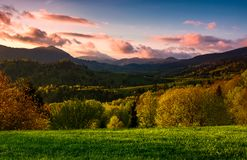 Forested hill at cloudy sunset in springtime. Beautiful scenery in Carpathian mountains. location - Mizhirya district of TransCarpathian region, Ukraine Royalty Free Stock Photo