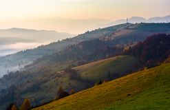 Forested hill on hazy autumn morning. Lovely countryside scenery Stock Photo