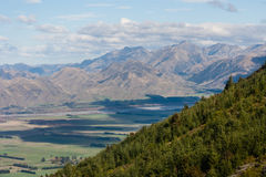 Forested hill in Southern Alps Royalty Free Stock Photography