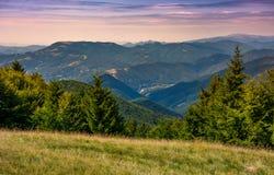 Forested hills over the Brustury valley at sunset. Gorgeous mountainous landscape, TransCarpathia, Ukraine Royalty Free Stock Photos