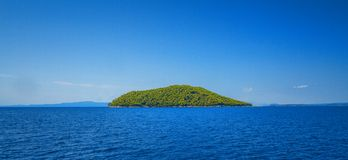 Forested island Royalty Free Stock Image