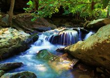 Forested Rocky Natural Spring Waterfall Royalty Free Stock Images