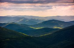 Forested rolling hills of Carpathian mountains. Gorgeous nature scenery on a cloudy summer day stock image