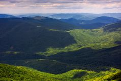 Forested rolling hills of Carpathian mountains. Gorgeous nature scenery on a cloudy summer day Stock Photography