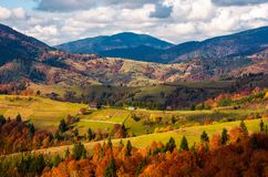 Forested rural area on rolling hills in autumn. Gorgeous mountain landscape on a cloudy day Royalty Free Stock Image