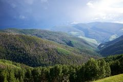 Forested valley with Vail mountain in background. Green forested valley with Vail mountain in background, Colorado, USA Stock Images