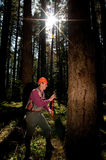 Forester in a Pacific Northwest. Forester marking Douglas fir trees with pink tape Royalty Free Stock Photography