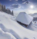 Forester's hut covered with snow in mountains Royalty Free Stock Image