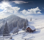 Forester's hut covered with snow in mountains Royalty Free Stock Images