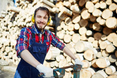 Forester. Successful lumber with cart working outdoors Royalty Free Stock Photos