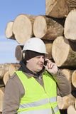 Forester with cell phone Royalty Free Stock Photo