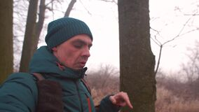 Forester video blogger walks along a path in the forest