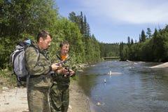 Foresters делают крюковину вокруг территории Стоковые Фото