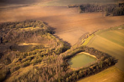 Forestry landscape aerial view. Forestry landscape seen from above with forest, lake and agriculture fields aerial view stock photography
