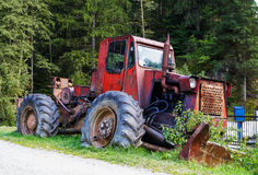 Forestry tractor. Old red forestry articulated tractor stock photos