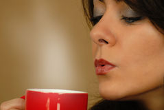 Foretasting her hot drink Royalty Free Stock Photo