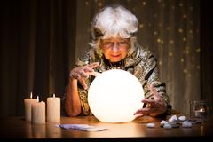 Foretelling future from crystal ball Stock Photo