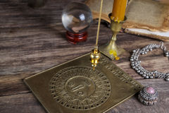 Foretelling the future with pendulum Stock Images