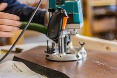 Foreuse Menuiserie de meubles Mode de vie de travail du bois, éléments écologiques organiques de conception images libres de droits