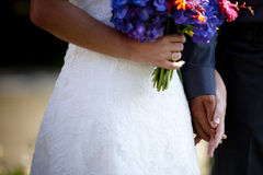 Forever. Bride and groom holding hands after just getting married with only the hands showing Royalty Free Stock Image