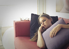 Forever alone. Woman on the coach alone at home Stock Image