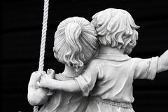 Forever in Love. Statue of couple on swing Stock Photography