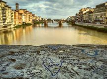 Forever love. Couples depicted on a brige in Florence Royalty Free Stock Image