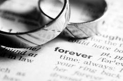 Forever together. Wedding rings near dictionary entry word forever, black and white stock photos