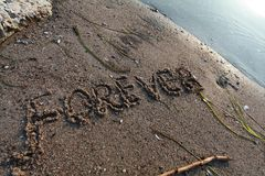 Forever written in the sand royalty free stock photo