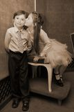 Forever young. Little girl kissing her younger brother Royalty Free Stock Images
