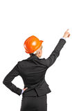 A forewoman in black suit pointing Stock Photography
