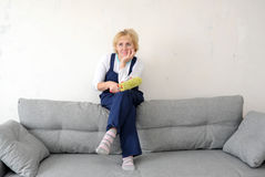 The forewoman has a rest on a sofa in the room Royalty Free Stock Images