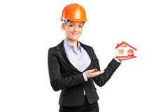 A forewoman holding a model house Royalty Free Stock Photo