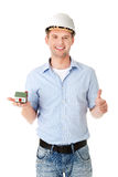 A forewoman holding a model house Stock Photos