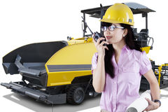 Forewoman and spreader machine asphalt Royalty Free Stock Photography