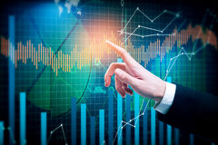 Forex concept. Pointing hand on creative business chart background. Forex concept Stock Photos