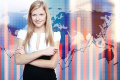 Forex concept. Portrait of attractive young woman standing on abstract background with map and business chart bars on grid. Forex concept. Double exposure Stock Image
