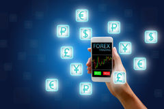 Forex concept, stock market, Woman holding smart phone and curre. Ncy icon Royalty Free Stock Image