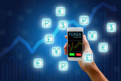 Forex concept, stock market, Woman holding smart phone and curre. Ncy icon and chart background Stock Photo