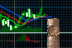 Forex. EURO coins with forex trading bars on background. Studio shot Stock Photography