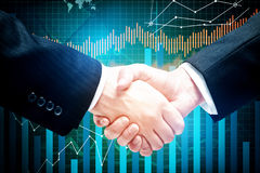 Forex and teamwork concept. Handshake on creative business chart background. Forex and teamwork concept Stock Photography