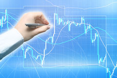 Forex trading. Concept with the hand and graph Royalty Free Stock Images