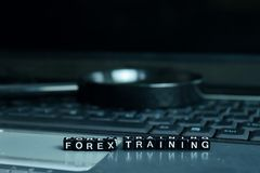 Forex Training text wooden blocks in laptop background. Business and technology concept stock images