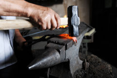Forge. Making a decorative element in the smithy on the anvil Royalty Free Stock Photography