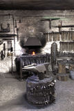Forge with anvil and hammers. Stock Photo