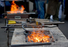 Forge braziers with tools at a festival of forge craft Royalty Free Stock Photography