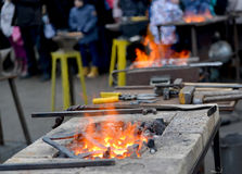 Forge braziers with tools on a holiday of forge craft Royalty Free Stock Images