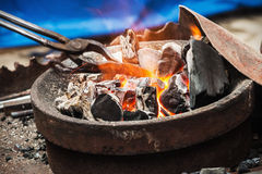 Forge a burning forge and tools Royalty Free Stock Images