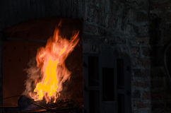 The Forge. Embers and flame from a forge stock photo